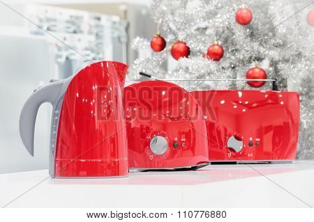 Red colored kettle and toasters in appliances store at Christmas