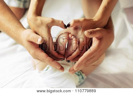 Family Hands Of His Father, Mother And child
