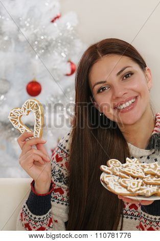 Attractive Young Woman With Home Cookies On Christmas Tree Background