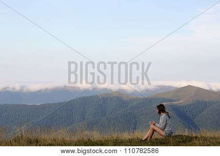 Woman With Tea In Mountains