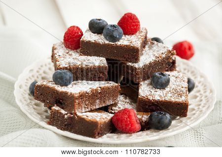Chocolate Brownies Decorated With Fresh Berries