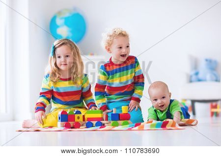 Kids Playing With Wooden Toy Train