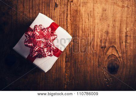 Gift Box On Wooden Desk