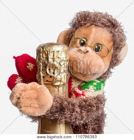 Toy Monkey Hugging Bottle Of Champagne Isolated On White Background. Symbol Of The Year Of Monkey.