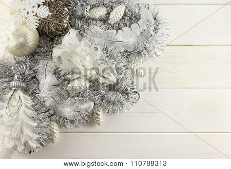 Christmas decoration - silver balls, silver cones, white snowflakes, silver pendants with feather