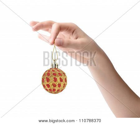 Female Hand Holding A Christmas Toy Isolated On White Background