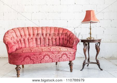 Red sofa couch in vintage room with lamp - classical style