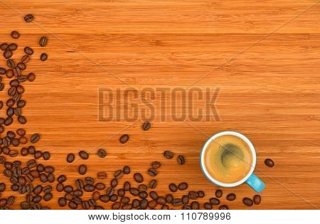 Coffee Cup And Beans Over Wood Background