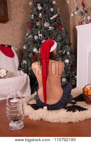 Christmas Interior. Girl In Red Hat