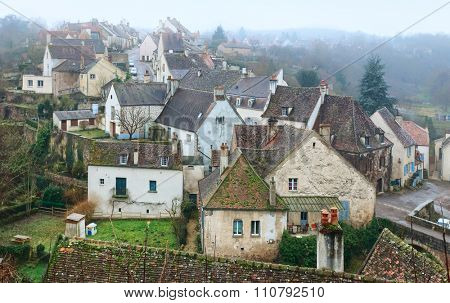 Foggy morning in Semur-en-Auxois. Burgundy, France
