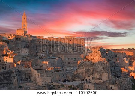 Panoramic View Of Typical Stones And Church Of Matera And The Madonna De Idris Under Sunset Sky