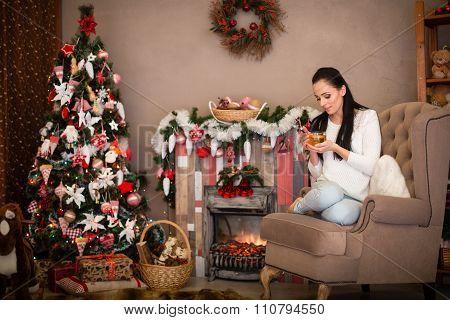 Happy Woman Near Christmas Tree.
