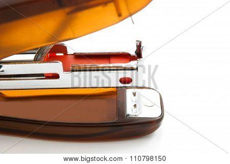 Orange Plastic Stapler On White