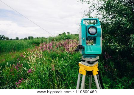 Blue Surveying   Equipment Total Station On A Background Of Meadow
