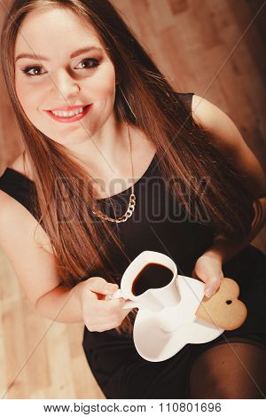 Smiling Woman Holding Heart Shaped Coffee Cup
