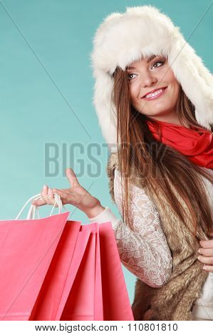 Woman With Bags Shopping. Winter Fashion.