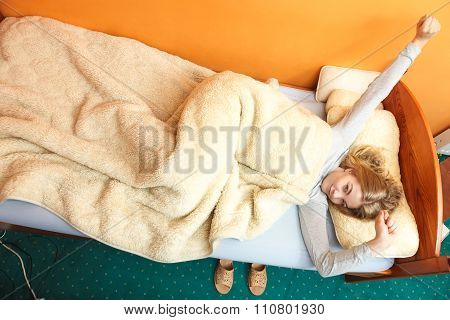 Woman Stretching In Bed In Morning After Sleeping