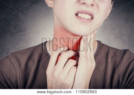 Little girl with sore throat  touching her neck.Sore throat sick