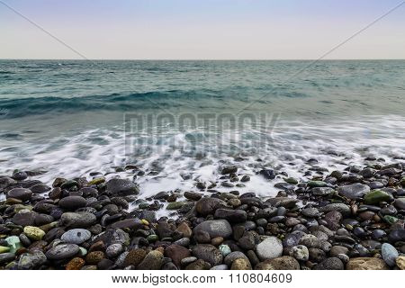 Stone Coast Of Ocean With Waves