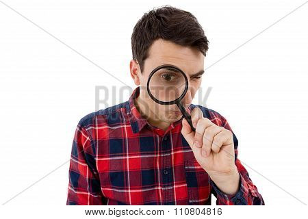 Surprised Young man student holding magnifying glass