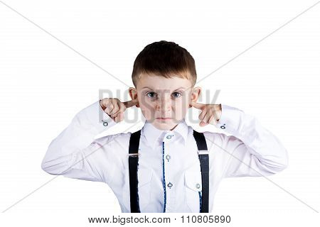 Angry unhappy irritated little boy covering ears