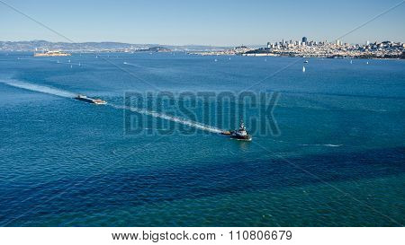 Tug boat tows a barge in the San Francisco Bay