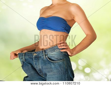 Young beautiful girl in jeans after losing weight