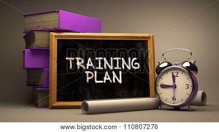 Training Plan Handwritten by white Chalk on a Blackboard.