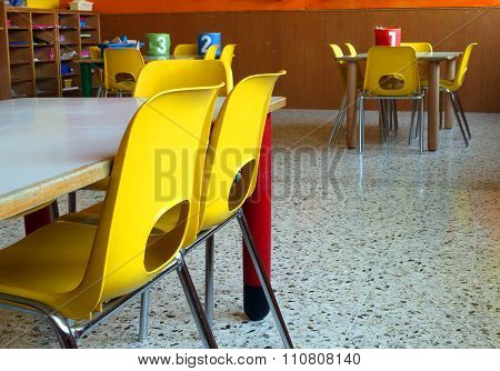 Classroom Of A Nursery With The Little Yellow Chairs