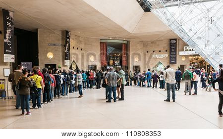 Long Lines Wait To Go Through Security At The Underground Louvre Entrance, Paris