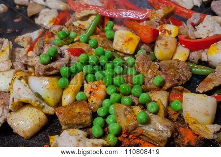 cooking spanish paella with beans and peppers