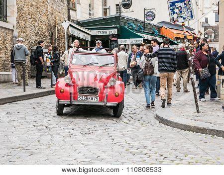 Shiny Red Antique Citroen Makes Way Through Montmartre Crowd, Paris
