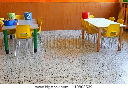 Classroom Of A Nursery With The Little Yellow Chairs And Tables