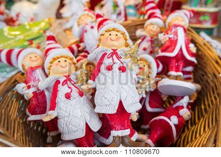 Christmas puppets in a basket.