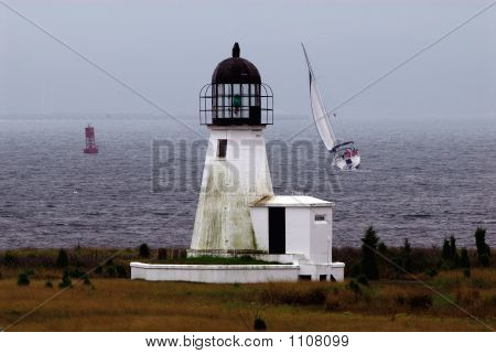 Lighthouse And Boat