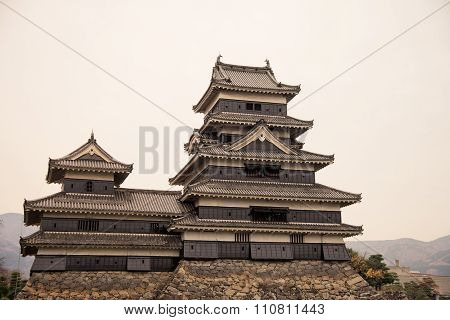 Masumoto Castle , Black Palace For War In Autumn At Nagano Province In  Japan With Clear Sky Vintage