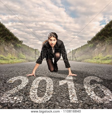 businesswoman on a road with year 2016 painted on it