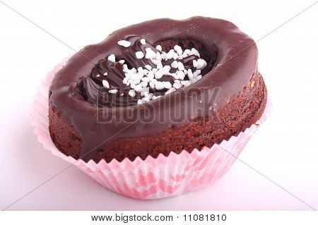 Chocolate cupcake decorated with chocolate frosting isolated on white background