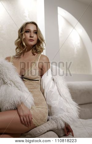 Glamorous blonde in erotic negligee and faux fur