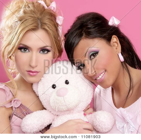 Blonde And Brunette Girls Hug A Pink Teddy Bear