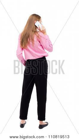 back view of a woman talking on the phone.  backside view of person.  Rear view people collection. Isolated over white background. Turning right girl talking on the phone.