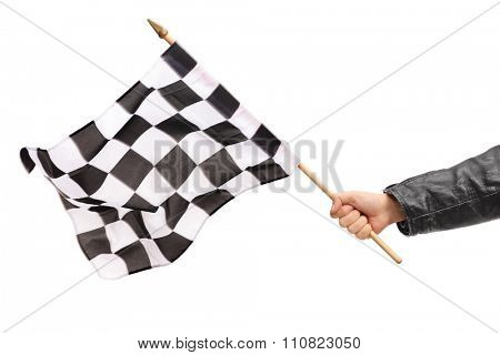 Studio shot of a male hand waving a checkered race flag isolated on white background