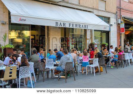 People Sitting In Ferrari Bar On Luigi Ferrari Square (piazza Luigi Ferrari)