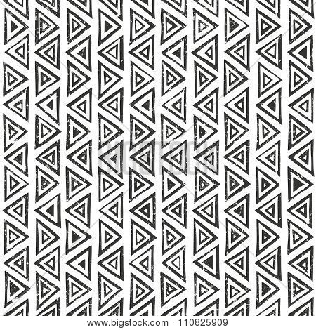 Abtract geometric pattern with triangles. Hand drawn tribal seamless background.