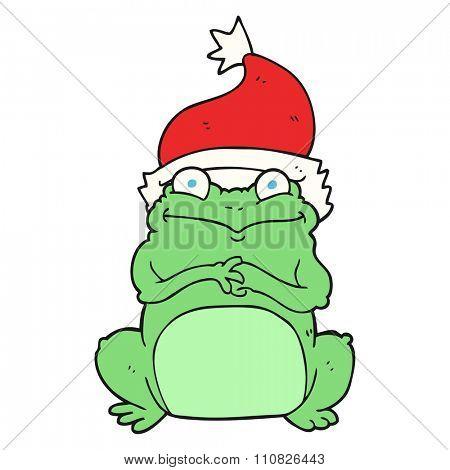 freehand drawn cartoon frog wearing christmas hat