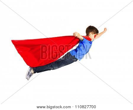 happiness, freedom, childhood, movement and people concept - boy in red superhero cape and mask flying in air