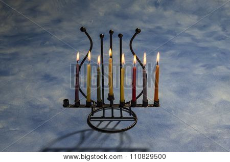 Seven burning Hanukkah candles in Menorah