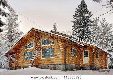 Modern Wooden Handmade Log Vacation Home During Winter.