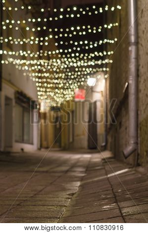 Narrow City Street Decorated With Festoon