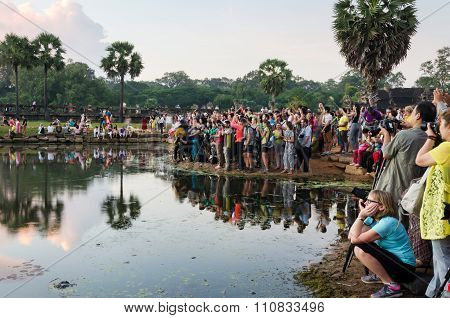 Siem Reap, Cambodia - December 3, 2015: Tourists Waiting For Dawn At Angkor Wat Temple